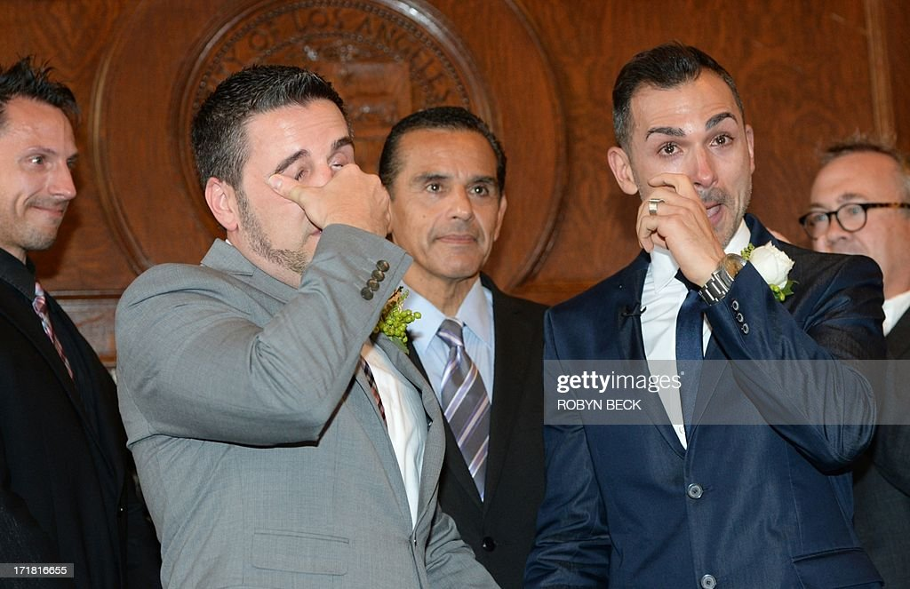 Same-sex couple Paul Katami (2nd-L) and Jeff Zarrillo (R) react after being married at Los Angeles City Hall June 28, 2013, becoming one of the first gay couples to marry in California since the Supreme Court refused to rule on Proposition 8 on June 26. Officiating at center is Los Angeles Mayor Antonio Villaraigosa