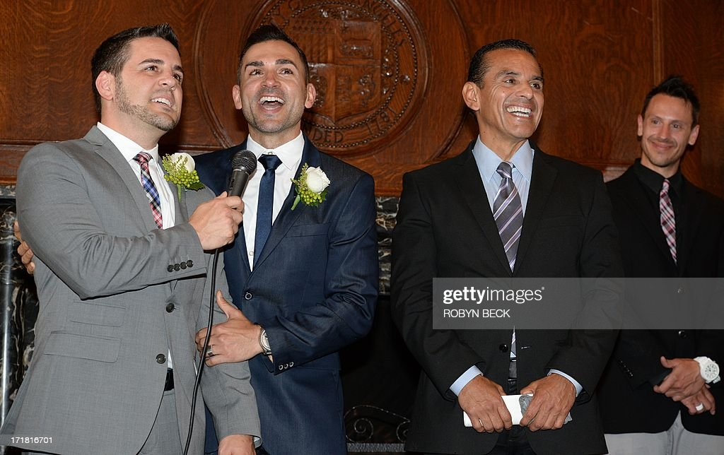 Same-sex couple Paul Katami (L) and Jeff Zarrillo (2nd-L) react after being married at Los Angeles City Hall June 28, 2013, becoming one of the first gay couples to marry in California since the Supreme Court refused to rule on Proposition 8 on June 26. Los Angeles Mayor Antonio Villaraigosa (2nd-R) officiated the ceremony.