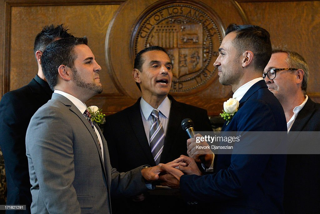 Same-sex couple Paul Katami (2nd R) puts the ring on Jeff Zarillo's (2L) finger as they are married at Los Angeles City Hall by Los Angeles Mayor <a gi-track='captionPersonalityLinkClicked' href=/galleries/search?phrase=Antonio+Villaraigosa&family=editorial&specificpeople=178925 ng-click='$event.stopPropagation()'>Antonio Villaraigosa</a> (C) as witnesses Devin Swanson (L) and Scott James look on, on June 28, 2013 in Los Angeles, California. The U.S. Ninth Circuit Court of Appeals lifted California's ban on same-sex marriages just three days after the Supreme Court ruled that supporters of the ban, Proposition 8, could not defend it before the high court. California Gov. Jerry Brown ordered all counties in the state to begin issuing licenses immediately.