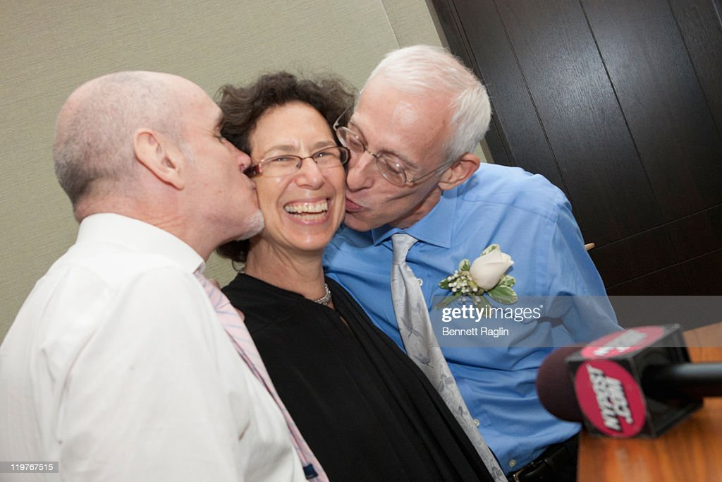 Same-sex couple Randy Faria and Frank Faria (R) give New York Supreme Court Judge Ellen Gesmer a kiss after the completion of the nuptials during the first day of legal same-sex marriage in New York State on July 24, 2011 in New York City.