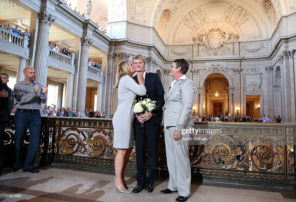 Same-sex couple Sandy Stier (L) and Kris Perry (R) kiss their son Elliot Perry (C) after they were married at San Francisco City Hall by California Attorney General Kamala Harris on June 28, 2013 in San Francisco, California. The U.S. Ninth Circuit Court of Appeals lifted California's ban on same-sex marriages just three days after the Supreme Court ruled that supporters of the ban, Proposition 8, could not defend it before the high court. California Gov. Jerry Brown ordered all counties in the state to begin issuing licenses immediately.