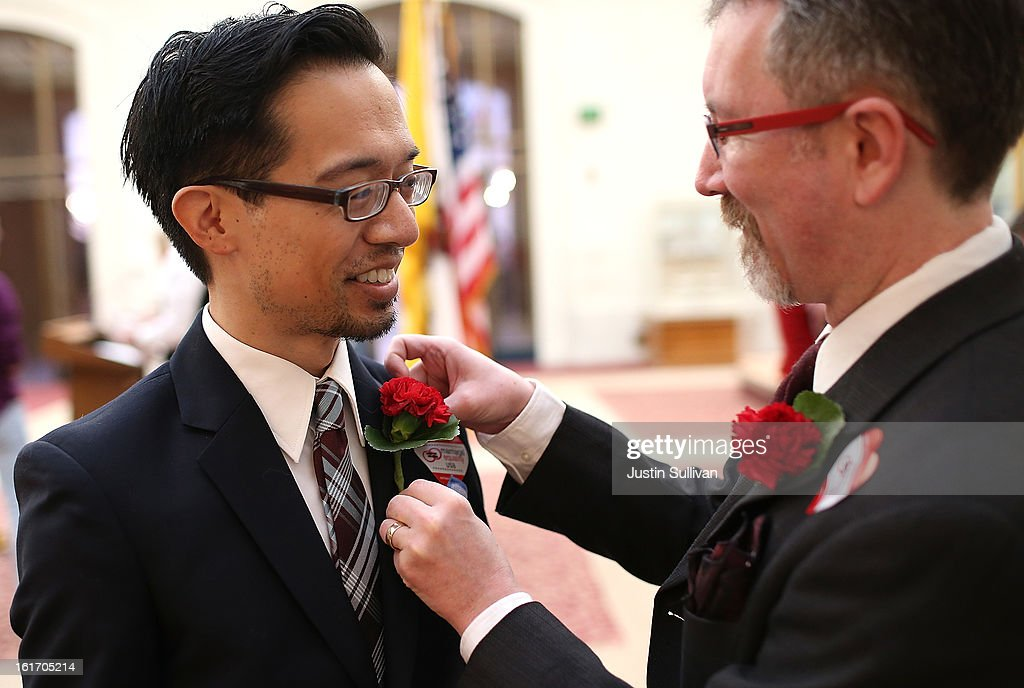 Same-sex couple Thom Watson (R) helps his husband Jeff Tabaco with a flower before they participated in a sit-in protest for same-sex couples who were denied marriage licenses from the San Francisco county clerk on February 14, 2013 in San Francisco, California. Close to a dozen same-sex couples who were denied marriage licenses were arrested after they staged a sit-in demonstration inside the office of San Francisco's county clerk.