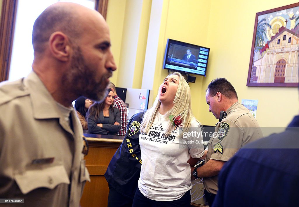 A same-sex marriage advocate shouts as she is arrested by San Francisco sheriffs deputies for staging a sit-in protest after same-sex couples were denied marriage licenses from the San Francisco county clerk on February 14, 2013 in San Francisco, California. Close to a dozen same-sex couples who were denied marriage licenses were arrested after they staged a sit-in demonstration inside the office of San Francisco's county clerk.