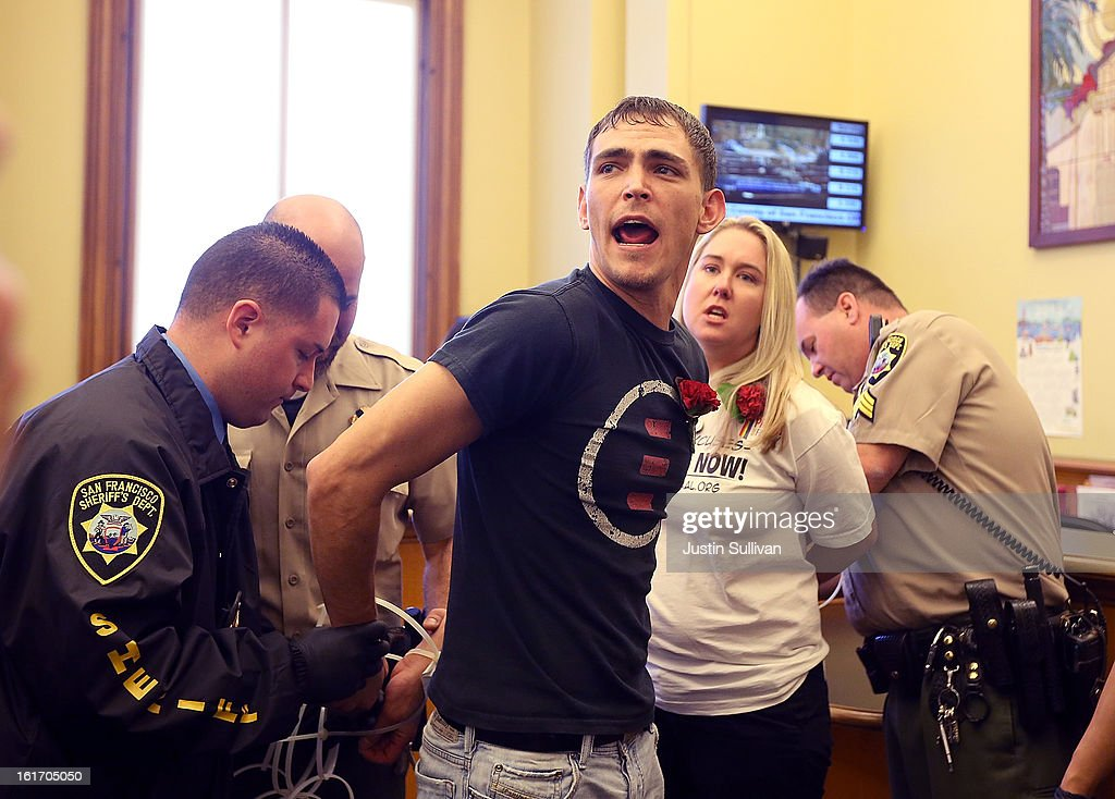 Same-sex marriage advocates shout as they are arrested by San Francisco sheriffs deputies for staging a sit-in protest after same-sex couples were denied marriage licenses from the San Francisco county clerk on February 14, 2013 in San Francisco, California. Close to a dozen same-sex couples who were denied marriage licenses were arrested after they staged a sit-in demonstration inside the office of San Francisco's county clerk.