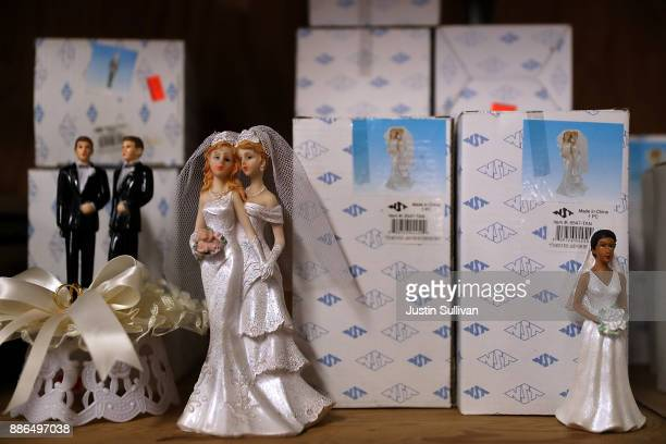 Samesex marriage cake toppers are displayed on a shelf at Fantastico on December 5 2017 in San Francisco California The US Supreme Court is hearing a...