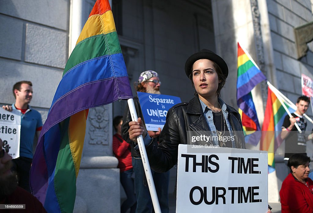 Same-sex marriage supporter Little Luciani holds a pride flag during a rally in support of marriage equality on March 26, 2013 in San Francisco, California. Supporters of same-sex marriage held a vigil after the U.S. Supreme Court heard arguments on California's Proposition 8, the controversial ballot initiative that defines marriage as between a man and a woman.