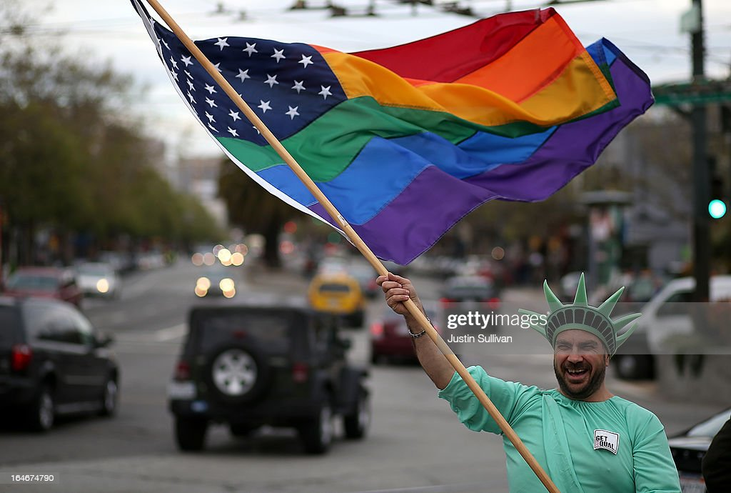 Same-sex marriage supporter Nikolas Lemos waves a Pride flag during a rally in support of marriage equality on March 25, 2013 in San Francisco, California. Supporters of same-sex marriage held a rally and are set to march through San Francisco a day before the U.S. Supreme Court will hear arguments on California's Proposition 8, the controversial ballot initiative that defines marriage as between a man and a woman.