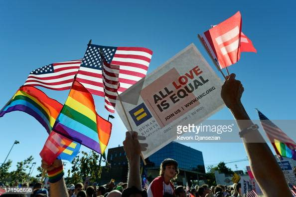 Samesex marriage supporters celebrate the US Supreme Court ruling during a community rally on June 26 2013 in West Hollywood California The Supreme...