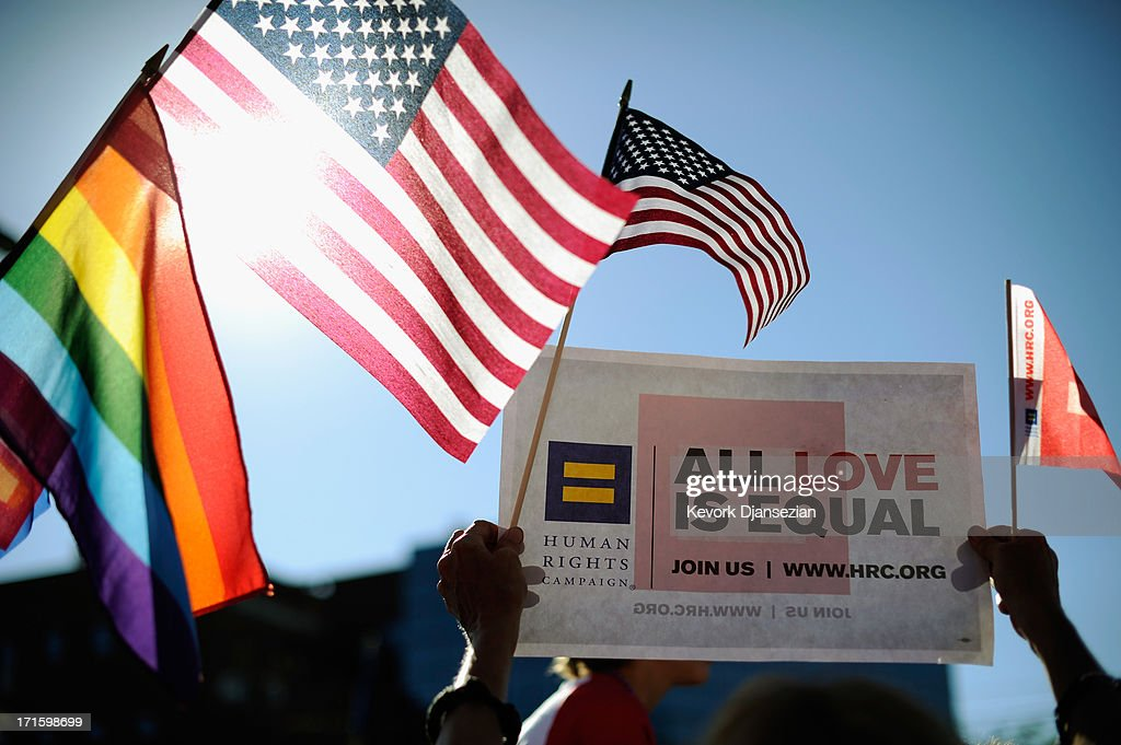 Same-sex marriage supporters celebrate the US Supreme Court ruling during a community rally on June 26, 2013 in West Hollywood, California. The Supreme Court struck down the Defense of Marriage Act (DOMA) and ruled that supporters of California's ban on gay marriage, Proposition 8, could not defend it before the Supreme Court.