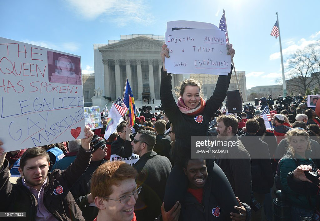 Same-sex marriage supporters demonstrate in front of the Supreme Court on March 27, 2013 in Washington, DC. The rights of married same-sex couples will come under scrutiny at the US Supreme Court on Wednesday in the second of two landmark cases being considered by the top judicial panel. After the nine justices mulled arguments on a California law that outlawed gay marriage on Tuesday, they will take up a challenge to the legality of the Defense of Marriage Act (DOMA). The 1996 law prevents couples who have tied the knot in nine states -- where same-sex marriage is legal -- from enjoying the same federal rights as heterosexual couples. AFP PHOTO/Jewel Samad