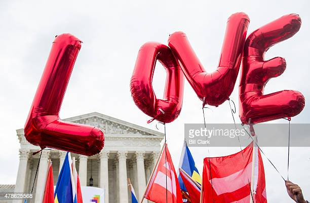 Samesex marriage supporters from the Human Rights Campaign fly 'LOVE' balloons in front of the US Supreme Court as they wait for the court's decision...