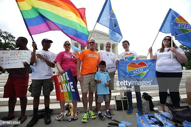Samesex marriage supporters hold rainbow flags outside the US Supreme Court June 26 2015 in Washington DC The high court ruled that samesex couples...