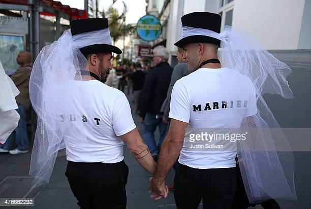 Samesex marriage supporters wear just married shirts while celebrating the US Supreme Court ruling regarding samesex marriage on June 26 2015 in San...
