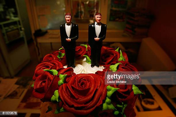 Samesex wedding cake topper figurines are seen at Cake and Art June 10 2008 in West Hollywood California Business is increasing sharply for local...