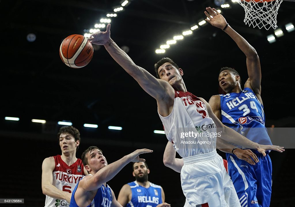 Samet Geyik (12) of Turkey in action against Giannis Antetokounmpo (34) of Greece during the friendly match at Abdi Ipekci Sports Hall in Istanbul, Turkey on June 26, 2016.
