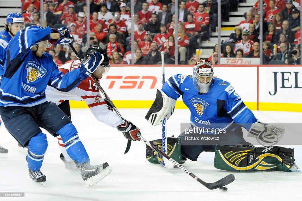 Sami Aittokallio of Team Finland gets down to stop the puck on a shot by Brett Connolly of Team Canada during the 2012 World Junior Hockey...