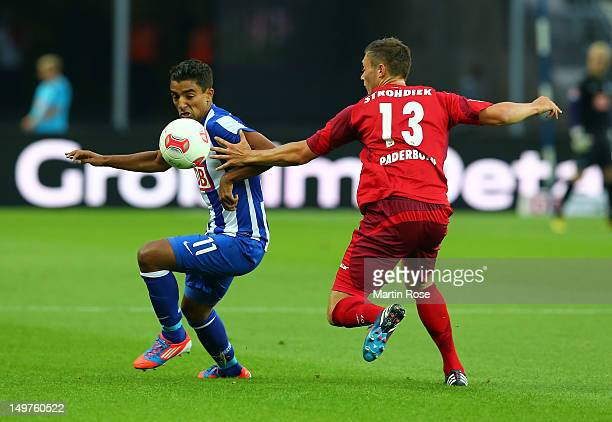 Sami Allagui of Berlin and Christian Strohdiek of Paberborn battle for the ball during the Second Bundesliga match between Hertha BSC Berlin and SC...
