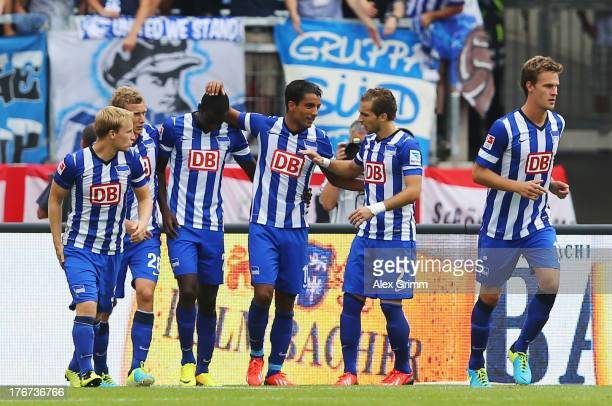 Sami Allagui of Berlin celebrates his team's first goal with team mates during the Bundesliga match between 1 FC Nuernberg and Hertha BSC Berlin at...