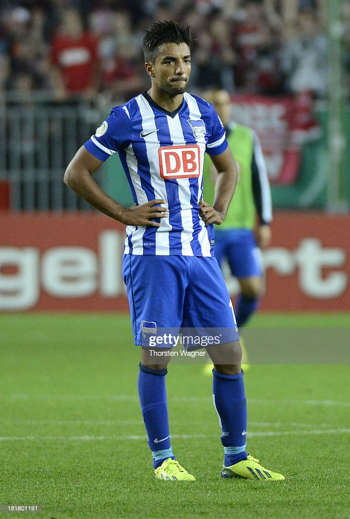 Sami Allagui of Berlin looks dejected after loosing the DFB Cup 2nd round match between 1.FC Kaiserslautern and Hertha BSC Berlin at Fritz-Walter-Stadion on September 25, 2013 in Kaiserslautern, Germany.