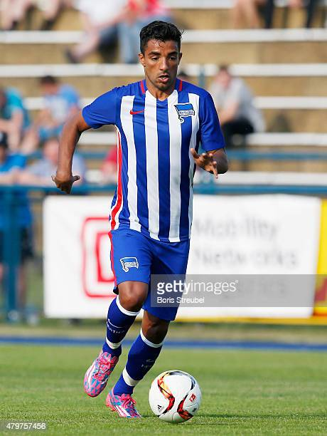 Sami Allagui of Berlin runs with the ball during a friendly match between Hertha BSC and Team DB at Waldstadion on July 3 2015 in Ludwigsfelde Germany