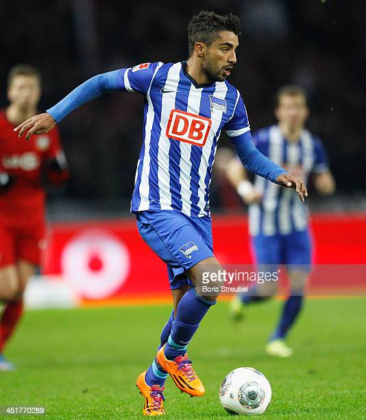 Sami Allagui of Berlin runs with the ball during the Bundesliga match between Hertha BSC and Bayer Leverkusen at Olympiastadion on November 23 2013...