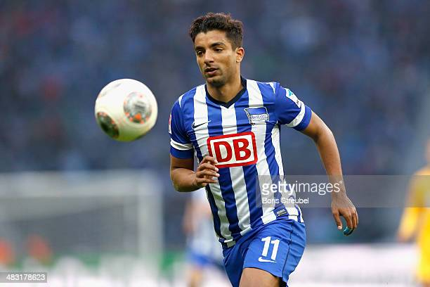 Sami Allagui of Berlin runs with the ball during the Bundesliga match between Hertha BSC and 1899 Hoffenheim at Olympiastadion on April 6 2014 in...