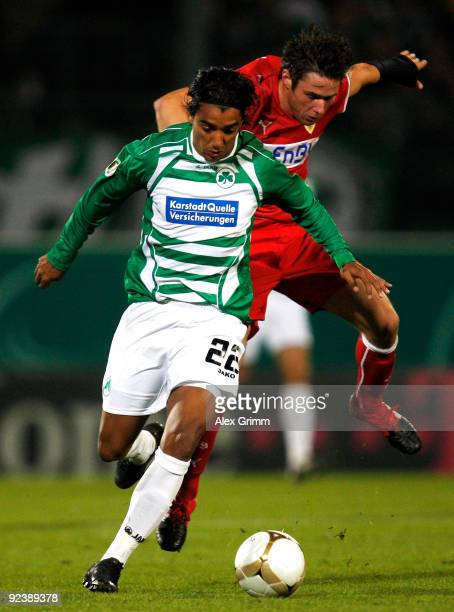 Sami Allagui of Greuther Fuerth is challenged by Christian Traesch of Stuttgart during the DFB Cup match between SpVgg Greuther Fuerth and VfB...