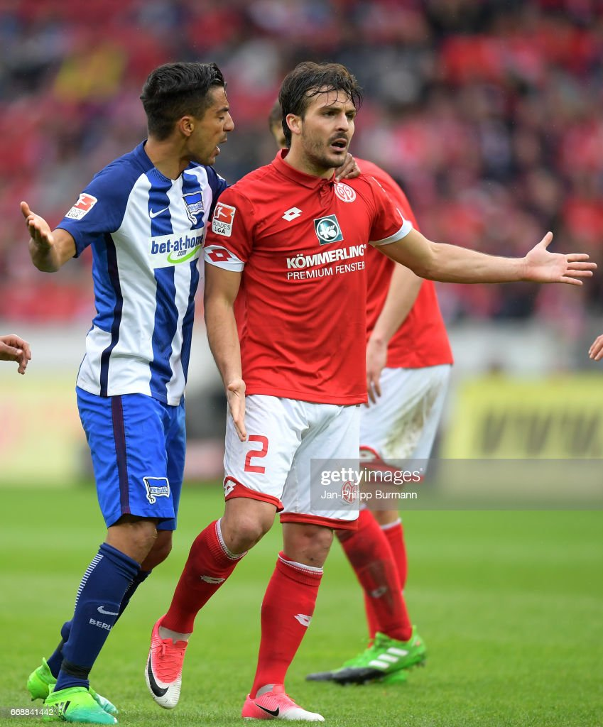 Sami Allagui of Hertha BSC and Giulio Donati of FSV Mainz 05 during the game between FSV Mainz 05 and Hertha BSC on april 15, 2017 in Mainz, Germany.