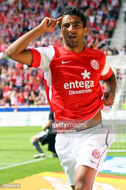 Sami Allagui of Mainz celebrates the first goal during the Bundesliga match between FSV Mainz 05 and Bayer 04 Leverkusen at Coface Arena on August 7...