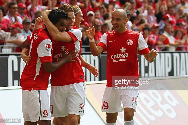 Sami Allagui of Mainz celebrates the first goal with Eugen Polanski and Elkin Soto during the Bundesliga match between FSV Mainz 05 and Bayer 04...