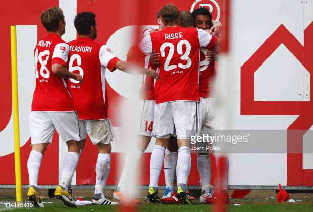 Sami Allagui of Mainz celebrates with his team mates after scoring his team's second goal during the Bundesliga match between FSV Mainz 05 and FC St...