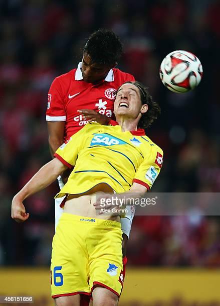 Sami Allagui of Mainz outjumps Sebastian Rudy of Hoffenheim during the Bundesliga match between 1 FSV Mainz 05 and 1899 Hoffenheim at Coface Arena on...