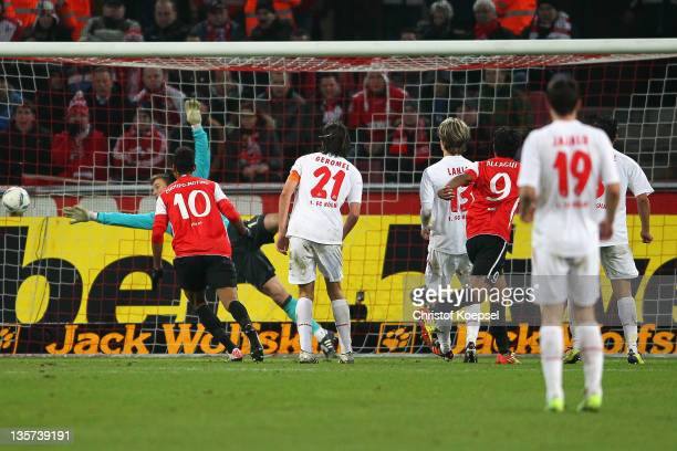 Sami Allagui of Mainz scores the first goal during the Bundesliga match between 1 FC Koeln and FSV Mainz 05 at RheinEnergieStadion on December 13...