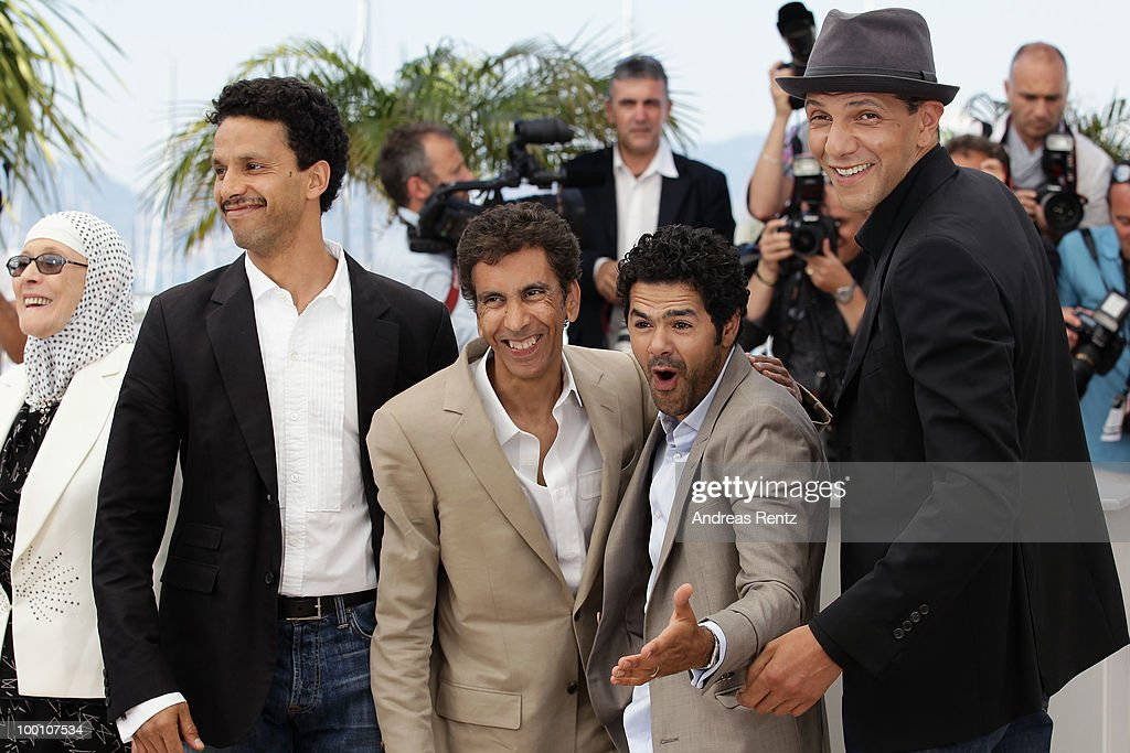 Sami Bouajila, Director Rachid Bouchareb, Jamel Debbouze and Roschdy Zem attend the 'Outside Of The Law' Photocall at the Palais des Festivals during the 63rd Annual Cannes Film Festival on May 21, 2010 in Cannes, France.
