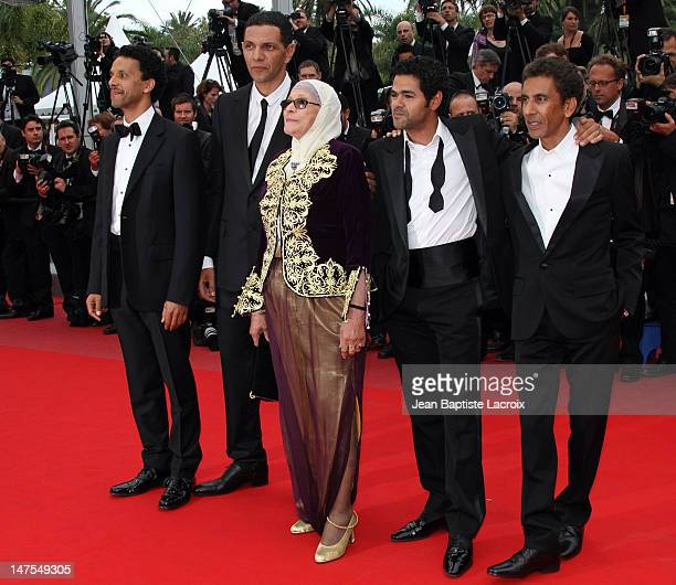 Sami Bouajila Roschdy Zem Chafia Boudraa Jamel Debbouze and Rachid Bouchareb attend the 'Outside the Law' premiere at the Palais des Festivals during...