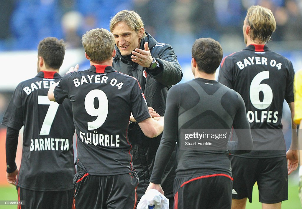 Sami Hyypia head coach of Leverkusen celebrates at the end with goal scorer Andre Schuerrle after the Bundesliga match between Hamburger SV and Bayer...