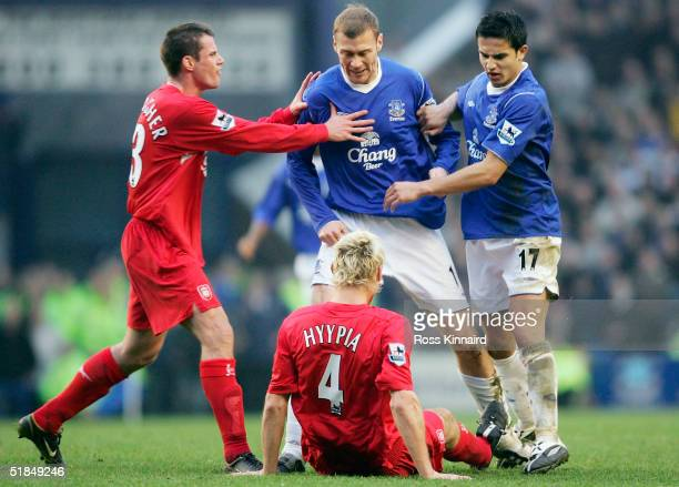 Sami Hyypia of Liverpool clashes with Duncan Ferguson of Everton during the Barclays Premiership match between Everton and Liverpool at Goodison Park...