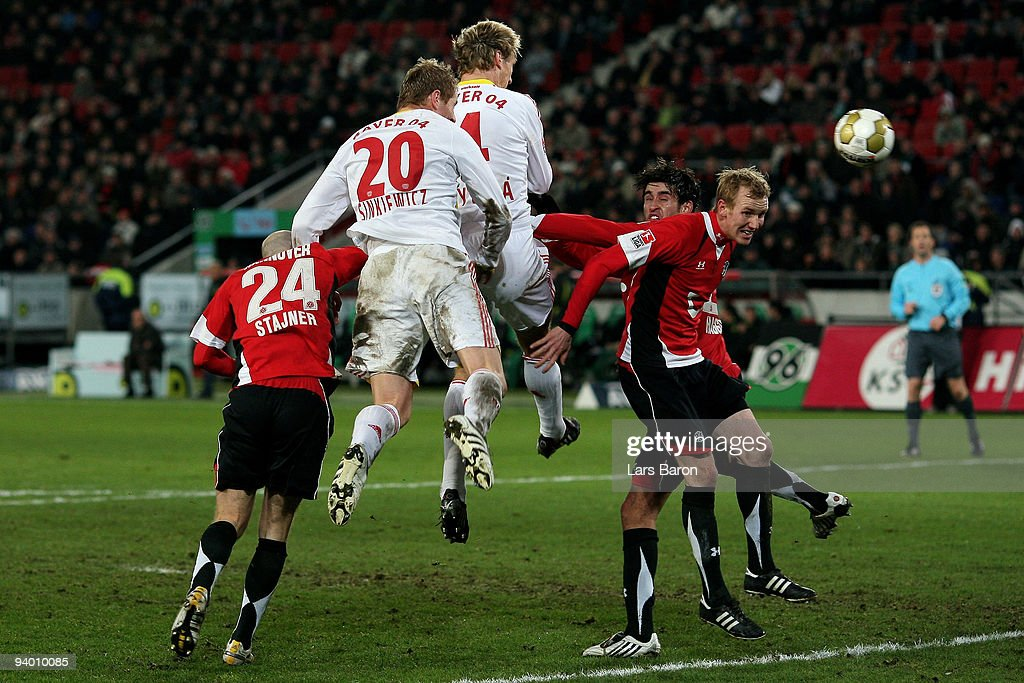 Sami Hyypiae of Leverkusen heads the ball to the goal during the Bundesliga match between Hannover 96 and Bayer Leverkusen at AWDArena on December 5...