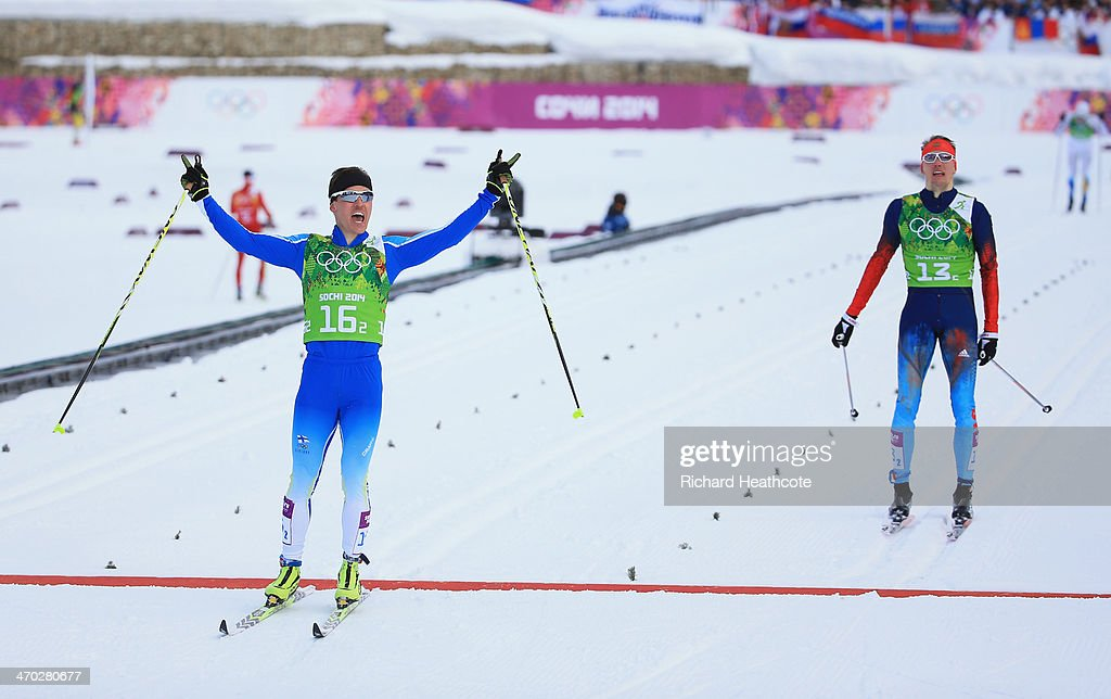 Sami Jauhojaervi of Finland celebrates as crosses the line to win the gold medal with team mate Iivo Niskanen of Finland (not pictured) ahead of <a gi-track='captionPersonalityLinkClicked' href=/galleries/search?phrase=Nikita+Kriukov&family=editorial&specificpeople=4907513 ng-click='$event.stopPropagation()'>Nikita Kriukov</a> of Russia (R) in the Men's Team Sprint Classic Final during day 12 of the 2014 Sochi Winter Olympics at Laura Cross-country Ski & Biathlon Center on February 19, 2014 in Sochi, Russia.