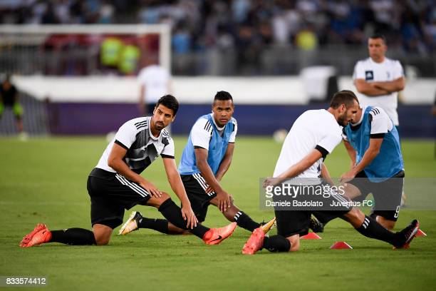 Sami Khedira Alex Sandro and Giorgio Chiellini warm up during the Italian Supercup match between Juventus and SS Lazio at Stadio Olimpico on August...
