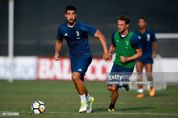 Sami Khedira and Claudio Marchisio of Juventus during a training session on August 7 2017 in Vinovo Italy