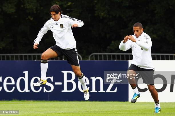 Sami Khedira and Dennis Aogo of Germany exercise during a training session ahead of their UEFA EURO 2012 qualifier against Austria on June 1 2011 in...