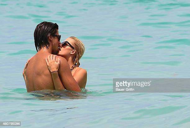Sami Khedira and his girlfriend Lena Gercke are seen while swimming in the ocean on July 12 2012 in Miami Florida