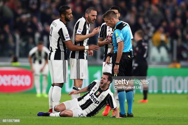 Sami Khedira and Leonardo Bonucci of Juventus FC protest to Referee Davide Massa during the Serie A match between Juventus FC and AC Milan at...