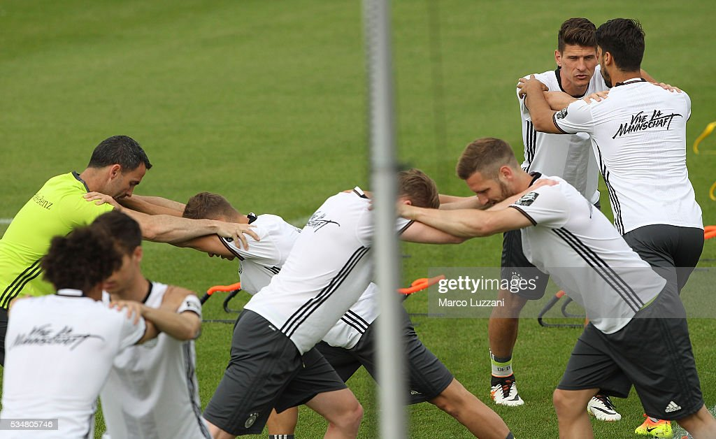 <a gi-track='captionPersonalityLinkClicked' href=/galleries/search?phrase=Sami+Khedira&family=editorial&specificpeople=2513712 ng-click='$event.stopPropagation()'>Sami Khedira</a> (R) and Mario Gomez (2nd R) of Germany train during the German national team's pre-EURO 2016 training camp on May 28, 2016 in Ascona, Switzerland.