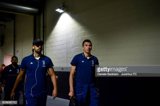 Sami Khedira and Mario Mandzukic of Juventus arrival before the International Champions Cup 2017 match between AS Roma and Juventus at Gillette...