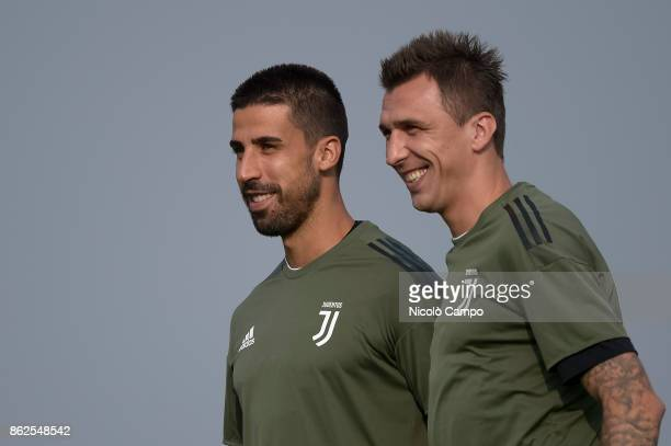 CENTER VINOVO TURIN ITALY Sami Khedira and Mario Mandzukic smile during Juventus FC training on the eve of the UEFA Champions League football match...