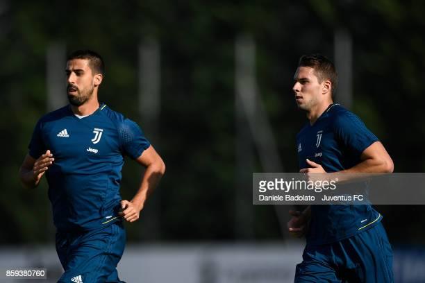 Sami Khedira and Marko Pjaca during a Juventus training session on October 9 2017 in Vinovo Italy