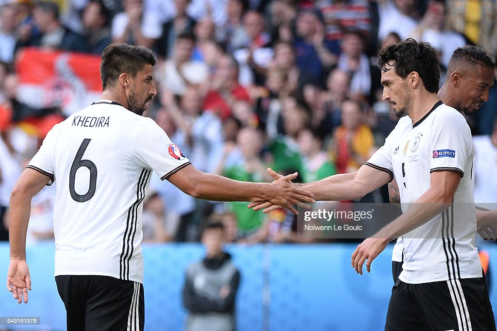 Sami Khedira and Mats Hummels of Germany celebrate Mario Gomez's goal during the European Championship match Round of 16 between Germany and Slovakia at Stade Pierre-Mauroy on June 26, 2016 in Lille, France.