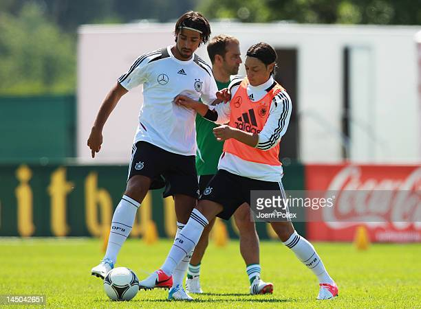 Sami Khedira and Mesut Oezil battle for the ball during a Germany training session at Stadium Tourrettes on May 23 2012 in Tourrettes Sur Loup France